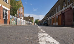 A white line running down the centre of an empty Colombia Road in east London