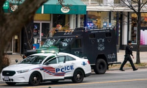 Police surround Comet Ping Pong, a pizza restaurant Washington, DC that was the subject of a fake news story claiming it was the center of a child sex ring orchestrated by Hillary Clinton