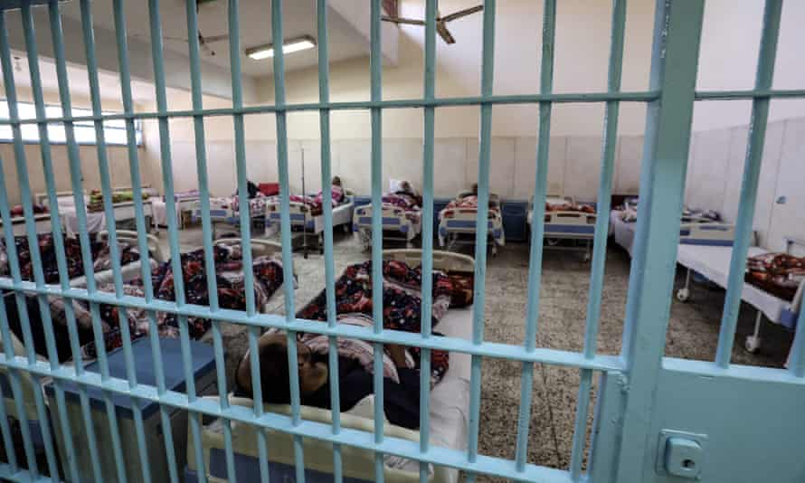 Prisoners being treated in the clinic of Borg el-Arab prison near the Egyptian city of Alexandria. Amnesty has highlighted a lack of basic care in the country's prisons.