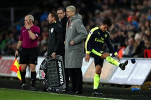 Arsenal's Alexis Sanchez kicks his gloves in frustration at being substituted.