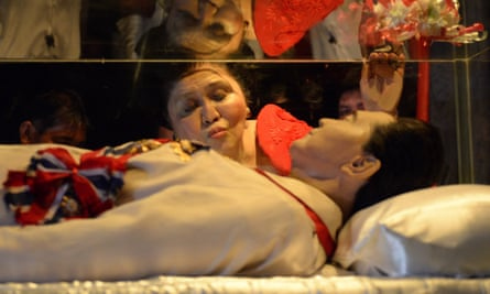 Former Philippine first lady Imelda Marcos kisses the glass case of her late husband in Batac town, Ilocos norte, north of Manila in 2014.
