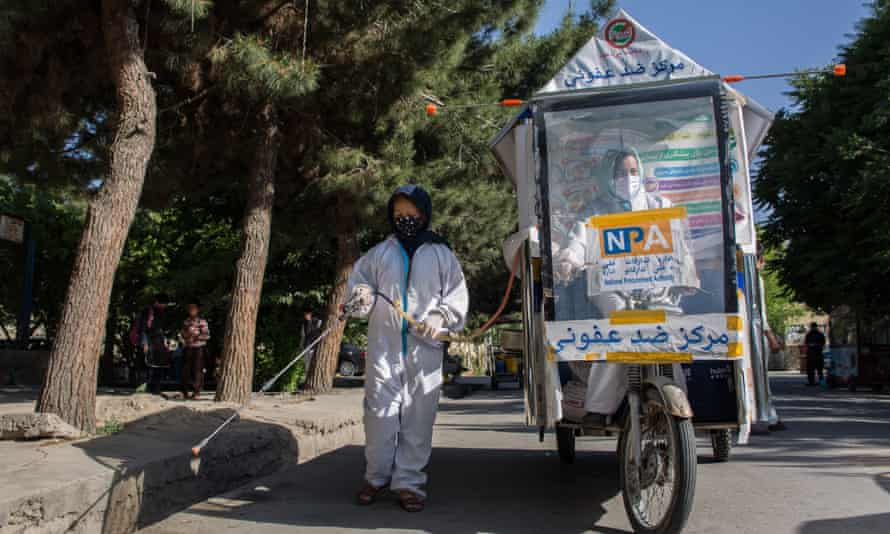 In Afghanistan's capital Kabul, food carts have been converted into mobile disinfection units.