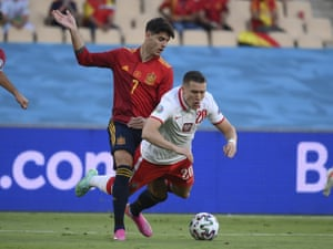 Poland's Piotr Zielinski goes to ground after a challange from Spain's Alvaro Morata.