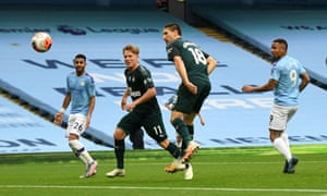 Manchester City's Gabriel Jesus has a shot on goal but the ball deflects off both Matt Ritchie (left) and Federico Fernandez (centre) for an own goal.