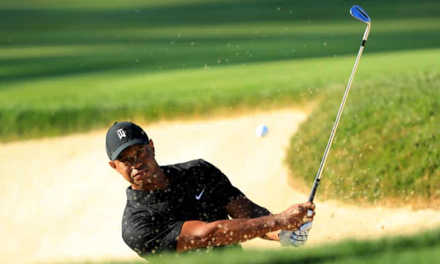 Tiger Woods plays from a bunker during a practice round prior to the Memorial Tournament at Muirfield Village in Ohio.