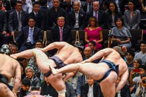 Trump and first lady Melania Trump are accompanied by Abe and his wife Akie Abe (centre row) as they watch a sumo demonstration.
