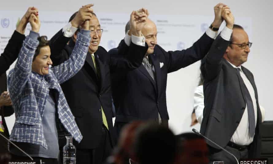 Delegates hail the adoption the adoption of a historic global warming pact at the COP21 climate conference