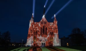 The Royal British Legion's falling poppy display is projected on to Salisbury Cathedral.