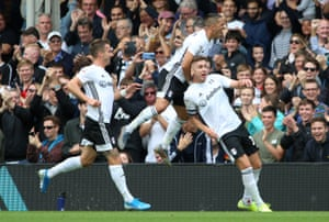 Fulham's Tom Cairney celebrates scoring the opening goal with Aleksandar Mitrovic.