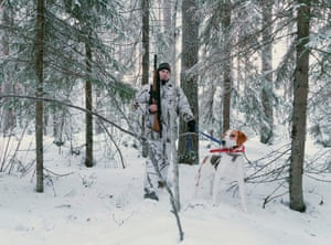 A hunter and his dog in the woods in North Karelia. Finland