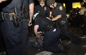 New York City police officers arrest someone during a protest in Brooklyn, New York, on 30 May 2020.