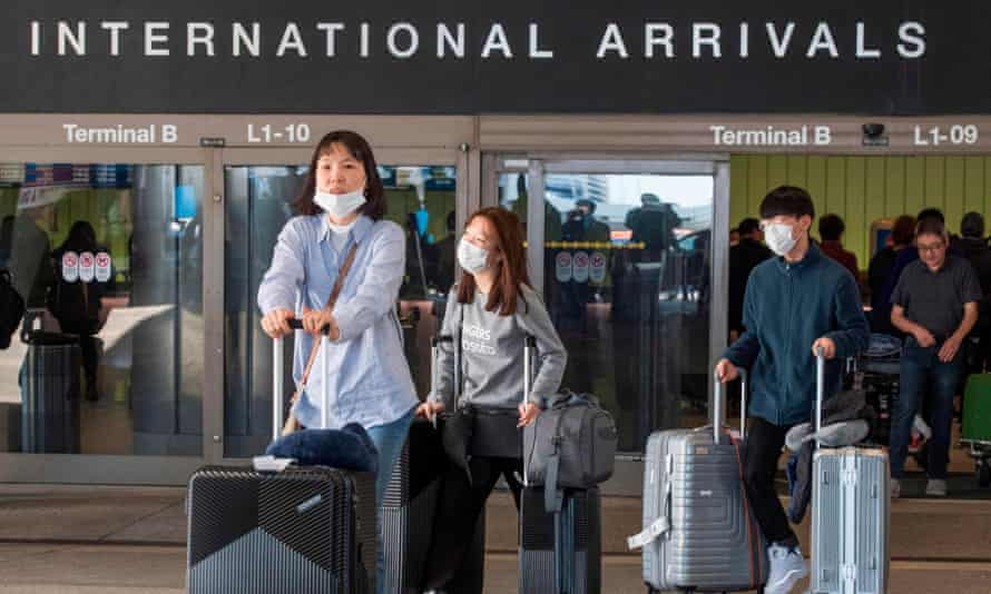 Passengers arrive on a flight from Asia, at Los Angeles International Airport, California, on February 2, 2020.