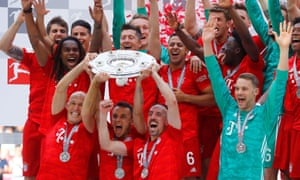 Bayern Munich's Arjen Robben, Rafinha and Franck Ribery lift the trophy as they celebrate winning the Bundesliga after playing their last game for the club.