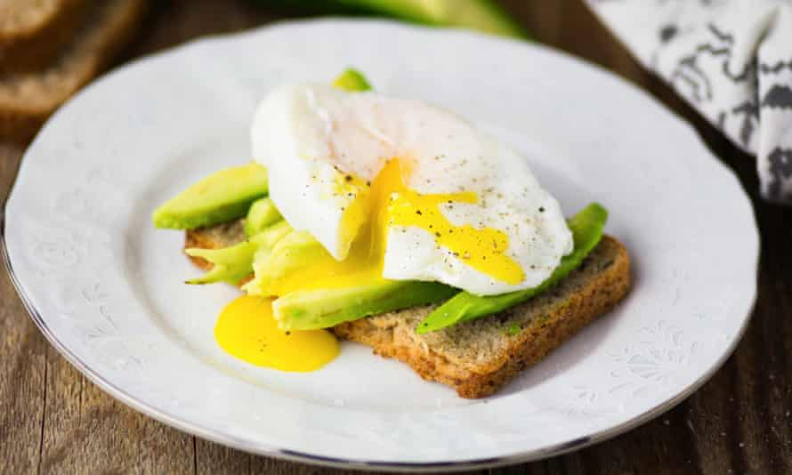 Fresh poached egg with avocado on toast.