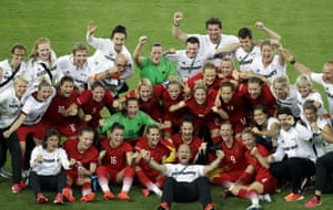 Germany's players and staff celebrate.