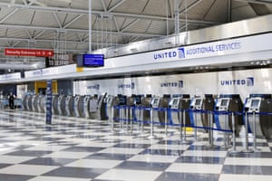 In this 25 June 2020 file photo, rows of United Airlines check-in counters at O'Hare International Airport in Chicago are unoccupied amid the coronavirus pandemic.