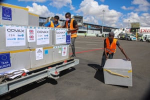 Workers unload boxes of Oxford/AstraZeneca Covid-19 vaccines after they arrived by plane at the Ivato international airport in Antananarivo, Madagascar.