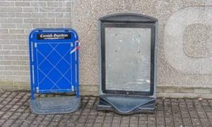 two empty newspaper boards