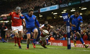 Maxime Medard clears the ball a split second before Liam Williams is able to ground it.