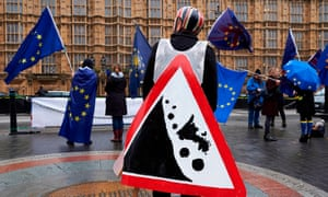 Pro-EU anti-Brexit demonstrators wave EU flags during a protest outside the Houses of Parliament in central London on December 13, 2017