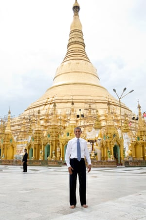 19 November: 'To some, this is just a snapshot and doesn't belong in this gallery of candid photographs from the year. But to me, it evokes what the trip to Burma was all about. Here is the president, shoes and socks off in respect, posing like an American tourist in front of the oldest pagoda in the world in a country that no US president had ever been able to visit'