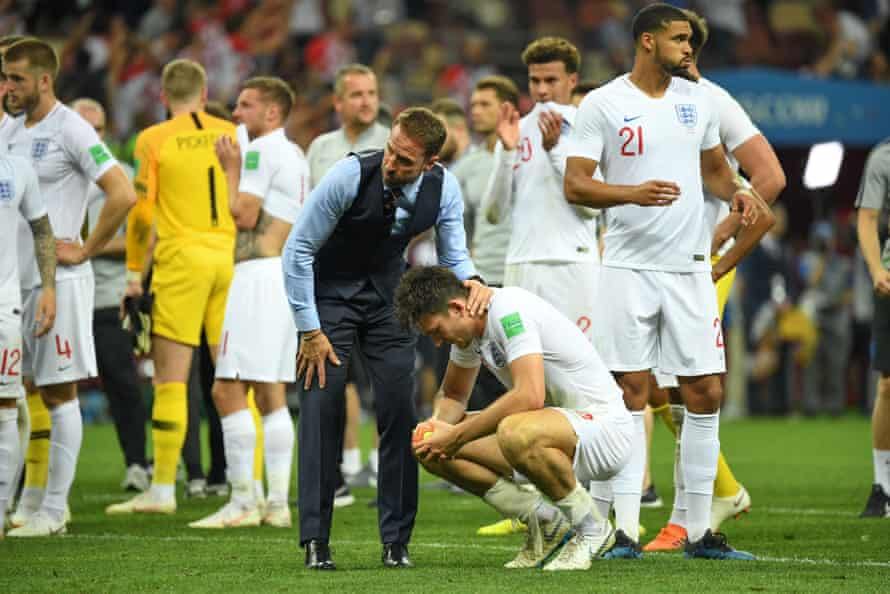 Gareth Southgate comforts Harry Maguire after England's defeat in the 2018 World Cup semi-final.