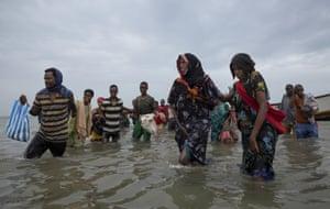 Ethiopian migrants disembark from a boat onto the shores of Ras al-Ara, Lahj, Yemen, 26 July