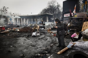 An artist paints during Ukraine's Maidan protests of 2014.