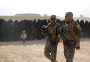 Fighters of Syrian Democratic Forces (SDF) walk together near Baghouz, Deir Al Zor provinceFighters of Syrian Democratic Forces (SDF), walk together near Baghouz