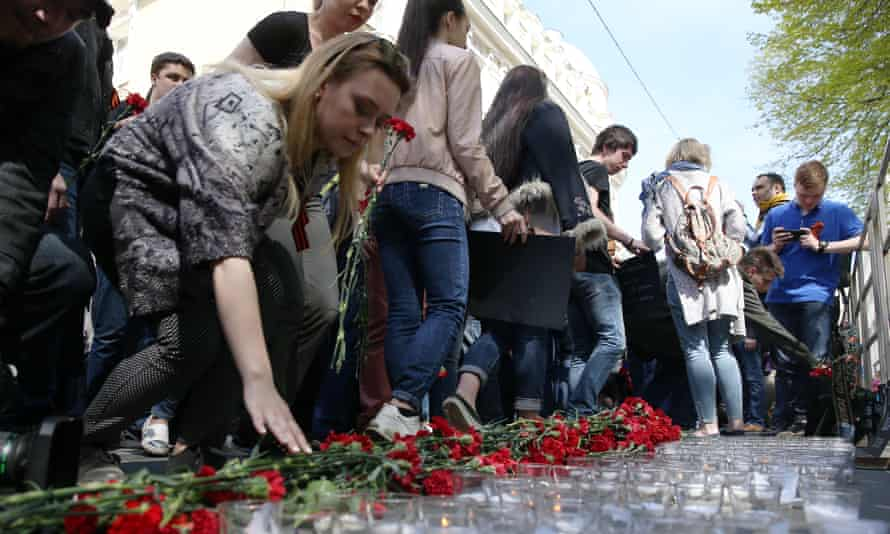 People lay flowers outside the Ukrainian embassy in Moscow in memory of the victims of the 2014 Odessa clashes.