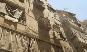 A boy stands on a balcony at a site hit by what activists said was a barrel bomb dropped by forces loyal to Syria's president Bashar al-Assad in Aleppo.