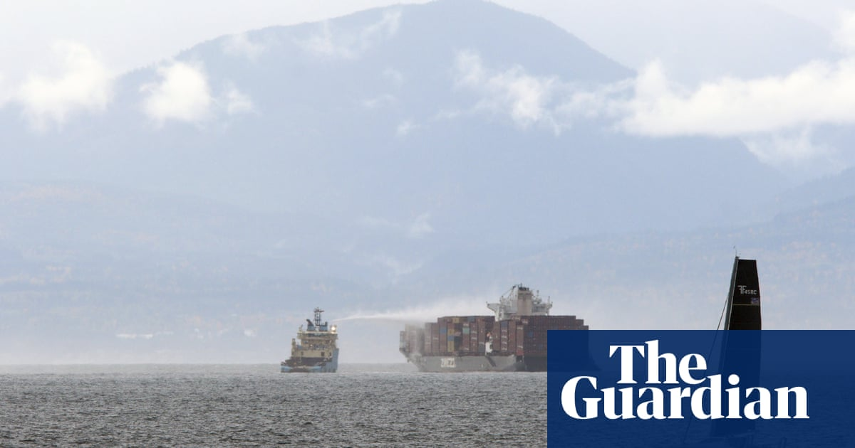 Canada container ship fire: 'bomb cyclone' storm may hinder effort to assess damage