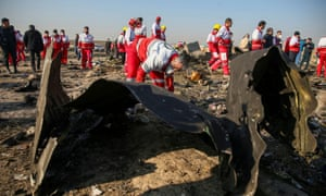 Red Crescent workers check the debris from the Ukraine International Airlines plane that crashed after take-off from Iran's Imam Khomeini airport