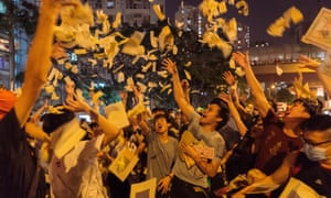 Anti-government protesters throw fake money in the air as a form of protest on Friday
