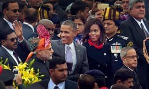 US President Barack Obama waves to the crowd flanked by Indian Prime Minister Narendra Modi and first lady Michelle Obama, as they leave at the end of India's annual Republic Day parade in New Delhi.