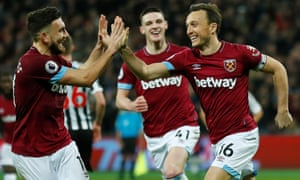 Mark Noble celebrates scoring West Ham's second goal against Newcastle with Robert Snodgrass as fellow goalscorer Declan Rice looks on.