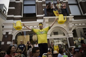 What better accessory for your yellow jersey than yellow plastic watering cans