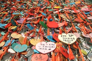 "Padlocks and heart-shaped wooden plates hang on the ""love confession"" wall in the capital of Shandong province"