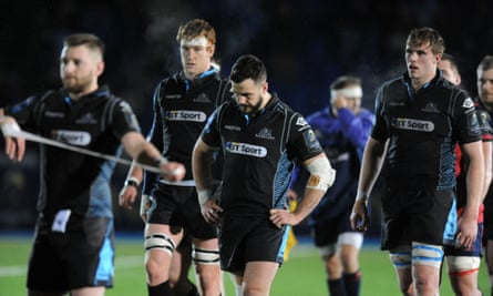 Glasgow players react after the agonising defeat to Munster at Scotstoun.