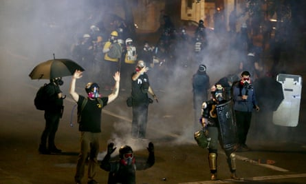 Police use teargas on protesters in downtown Portland on 13 August.