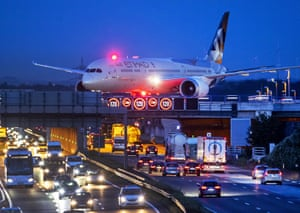 Frankfurt, Germany: An aircraft crosses a bridge over a highway at the airport