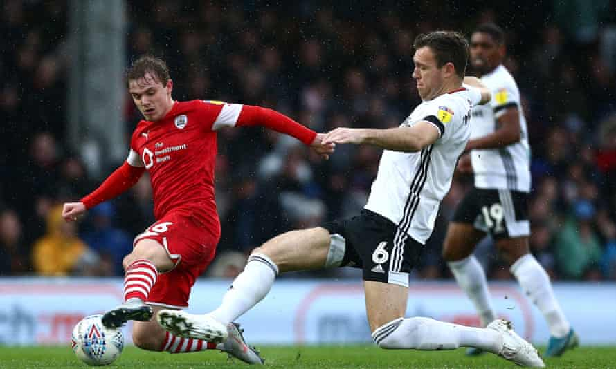 Kevin McDonald (centre, No 6) in action for Fulham against Barnsley last season.