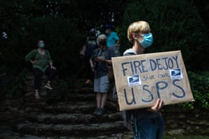 A group of protestors hold a demonstration in front of Postmaster General Louis DeJoy's home in Greensboro, North Carolina on August 16, 2020. -
