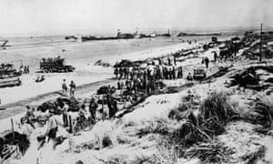 Allied forces soldiers on landing on a beach in Normandy, north-western France, 6 June 1944.