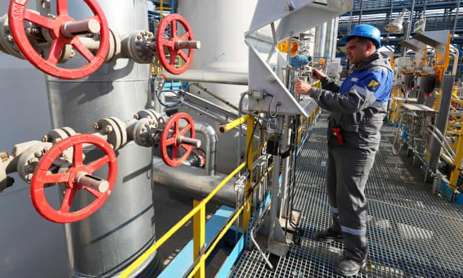 A worker checks measuring equipment at the Slavyanskaya compressor station operated by Gazprom, the starting point of the Nord Stream 2 pipeline