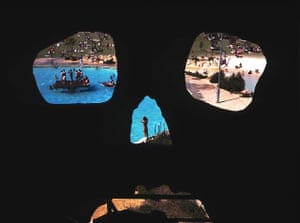 Look out... A giant skull's eye view of holidaymakers at a water theme park in Perth, Western Australia