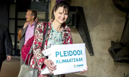 Marjan Minnesma, director of the environmental group Urgenda, arrives at court in The Hague