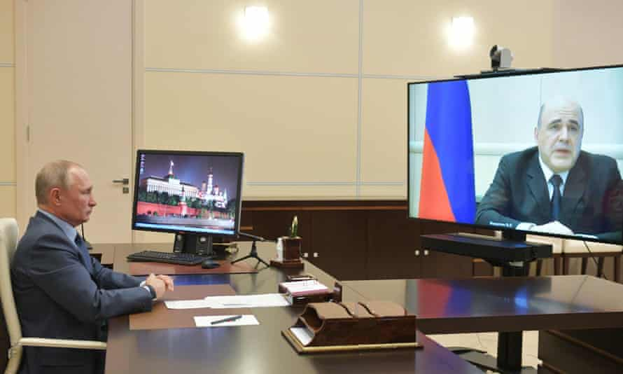 The Russian president, Vladimir Putin, speaks with Mikhail Mishustin on 30 April.