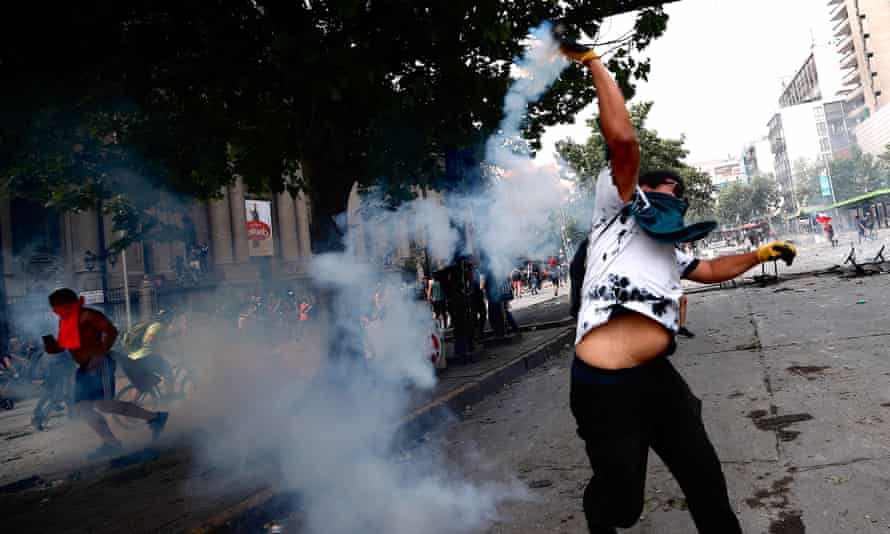 Demonstrators clash with police on the sixth day of protests against the Government, in Santiago, Chile, on Wednesday.