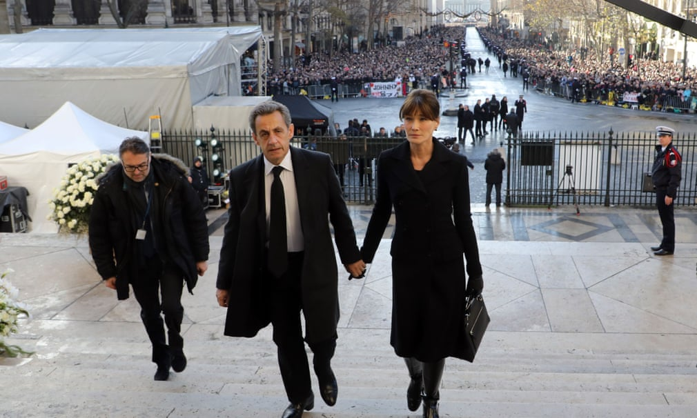 Former French president Nicolas Sarkozy arrives at the funeral ceremony with his wife Carla Bruni